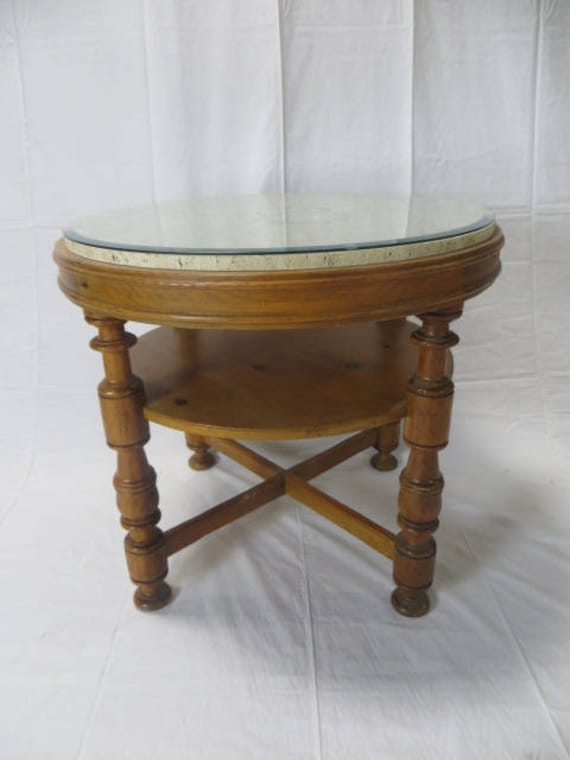 Baker Solid Pine Distressed Round Table with Travertine Top with Beveled edge Glass protector and Turned Legs with one shelf