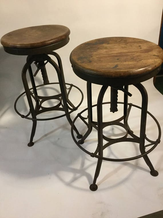 SOLD: Ca. 1950s Toledo Metal Furniture Co. Maple/Steel Adjustable Pair of Industrial Stools From The US Mint in PA.