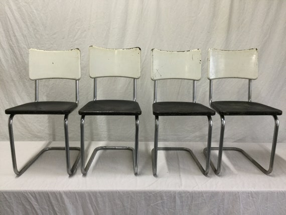 SOLD - Original Machine Age Deco Steel Cantilevered Side Chairs by Howell in Distressed Cream and Black Seats