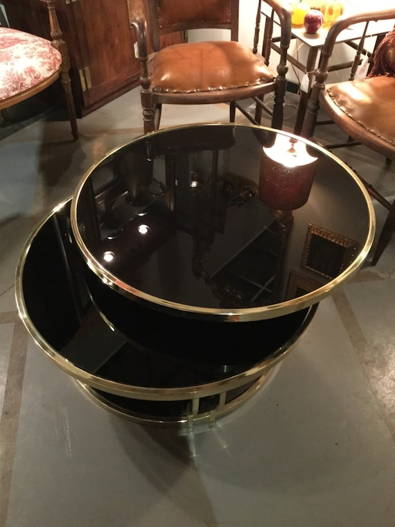 SOLD: Brass and Black Glass Swivel Cocktail Table by Design Institute of America REDUCED FROM 3200