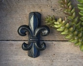 Fleur de lis door knocker for front door. Made of cast iron and finished in gunmetal black.