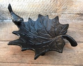 Maple leaf jewelry dish with a small bird. Solid and sturdy cast iron.