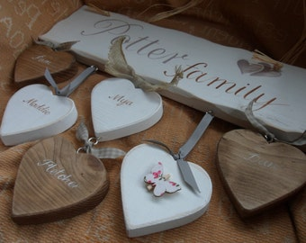 """Gifts for the whole family.""""Family this home is filled with love and dreams"""", a handmade shabby chic plaque with personalised little hearts."""