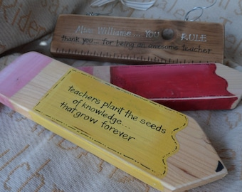 Personalised teacher thank you gifts and keepsakes. A ruler or a pencil with a  personal quote. A teacher plants the seeds of knowledge