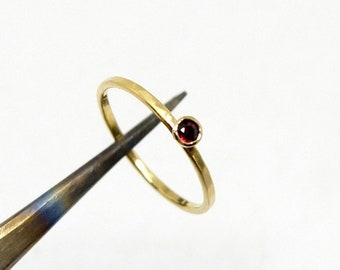 Forged gold ring with a red sapphire, delicate 18K yellow gold engagement ring with red gemstone in size 52 or size of your choice