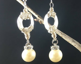 silver dangle wire wrapped earrings adorned with faux pear and diamond embellishments