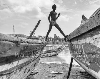 Senegalese Boy Walking on the Boats, Travel Photography, African Black and White Photography, Fine Art Photography, Vertical Wall Art Print