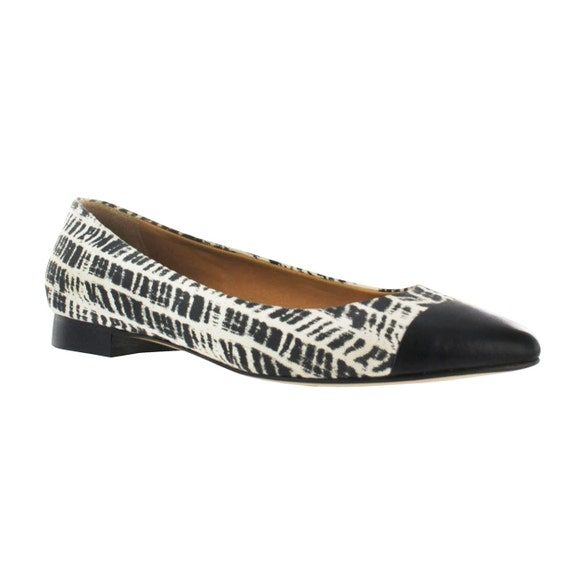 Black and white leather pointy flats