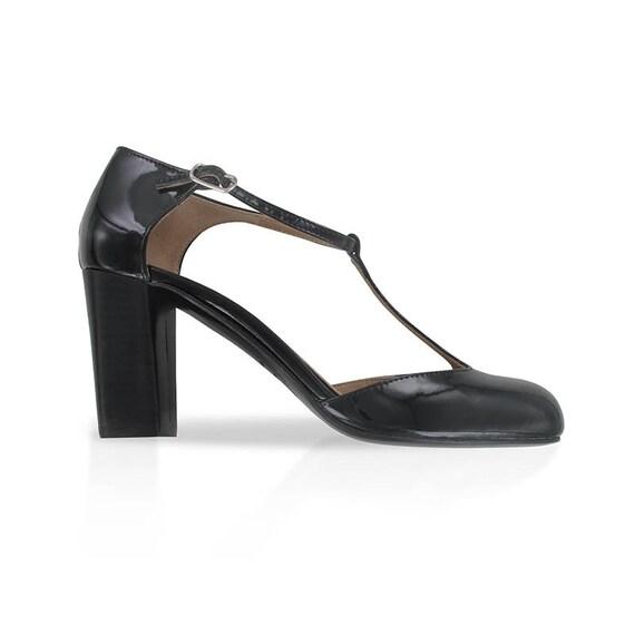 ee3fa830da61 T strap black leather shoes