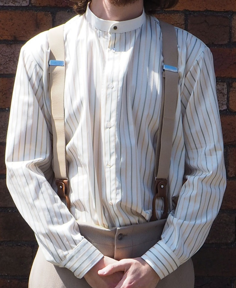 1920s Men's Shirts and Collars History Collarless shirt in off-white with satin stripe in olive and gold cream neckband fastened with vintage collar stud all sizes $71.07 AT vintagedancer.com