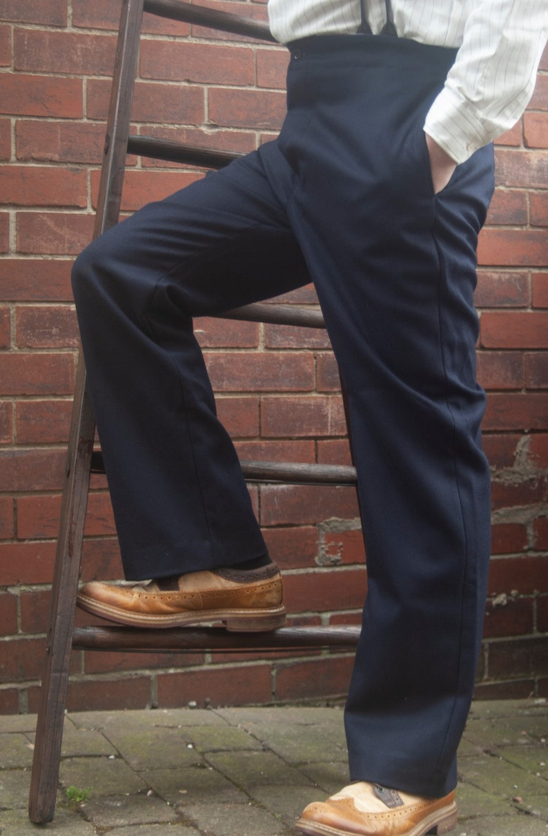 1920s Men's Pants History: Oxford Bags, Plus Four Knickers, Overalls high waist trousers in navy blue wool serge with button fly and brace buttons $106.30 AT vintagedancer.com