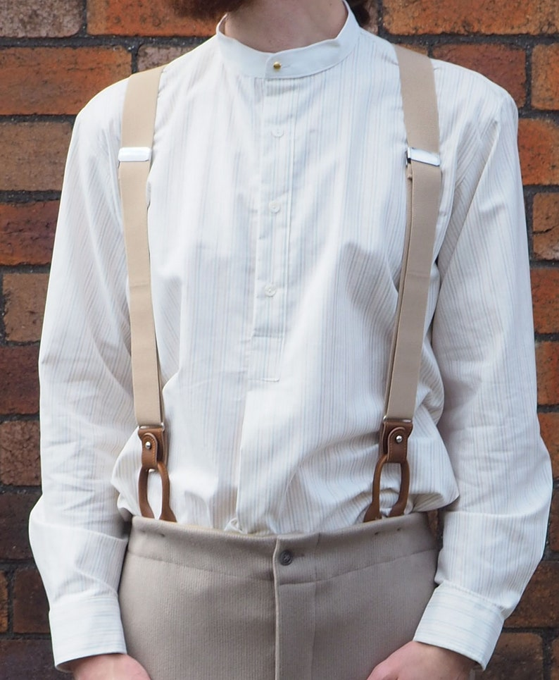 1920s Men's Shirts and Collars History Collarless cotton shirt with stripes in subtle shades cream neckband cream neckband fastened with vintage collar stud all sizes $81.07 AT vintagedancer.com