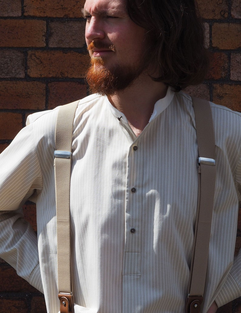 1920s Men's Shirts and Collars History Collarless shirt in khaki and cream stripe cotton with cream neckband fastened with vintage collar stud $71.07 AT vintagedancer.com