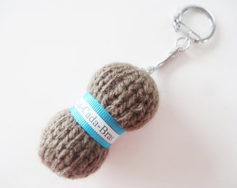 Keychain / bag charm in the form of Brown yarn