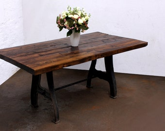Jeremie 150 year old Reclaimed Wooden Roof Rafters Table jointed with Oversized Hand-cut Dovetail Joints with Vintage Cast Iron Legs