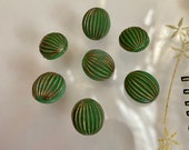 Set of 7 Vintage Glass Buttons. Green. Gold Lustre.