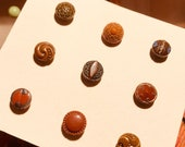 Vintage Glass Button Collection of 9 chocolate babies.