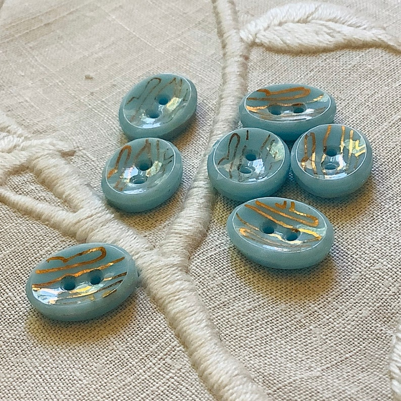 Set of 7 Pale Sky Blue Glass Buttons. Oval. Sew Through. Small image 0