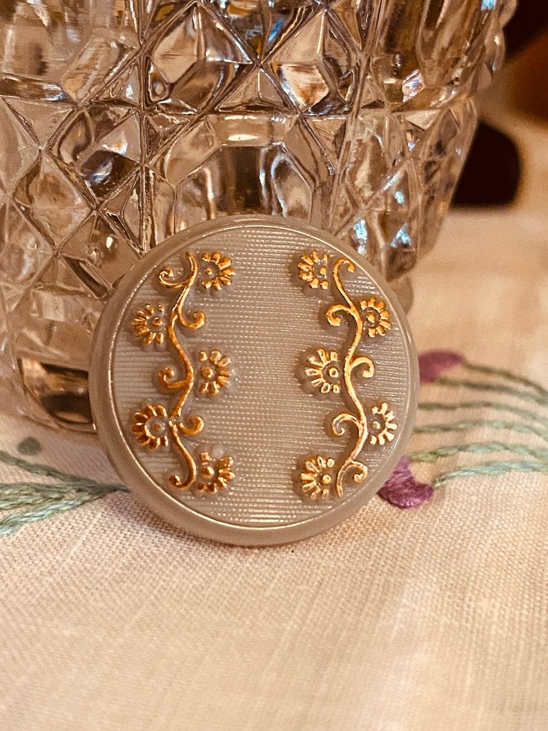 Vintage Grey Glass Button. Self-Shank. Gold Lustre Flowers image 0