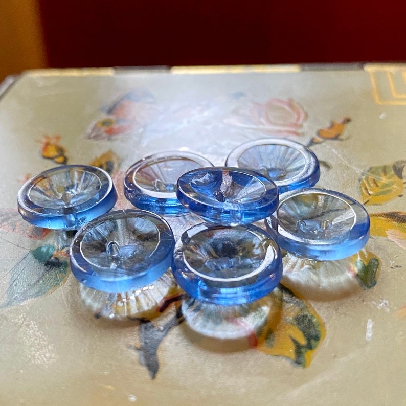 Set of 7 Transparent Blue Glass Buttons. image 0