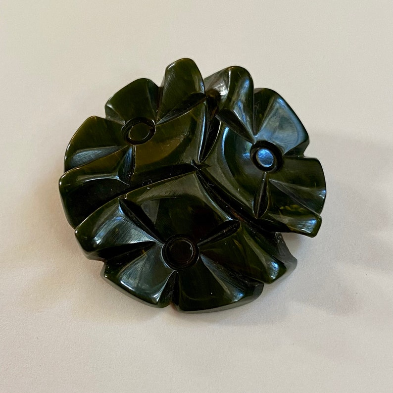Vintage Green Bakelite Button. Carved Flowers. image 0