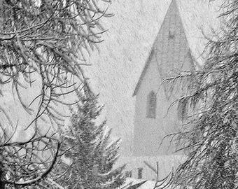 Swiss church through  an opening in the forest