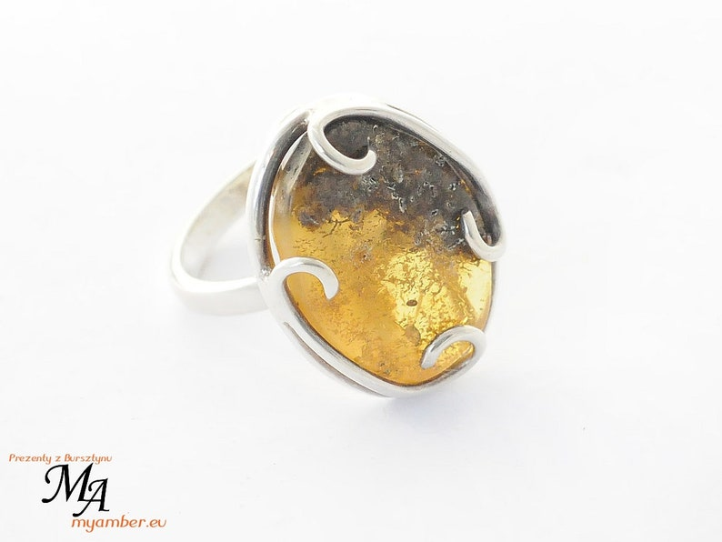 Silver adjustable Certificate 11738 Ring with Amber stone