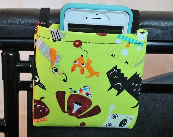 Fun Dogs on Lime Green FabricArmrest Hanging Cell Phone Holder for a Wheelchair, Walker or other Mobility Aides