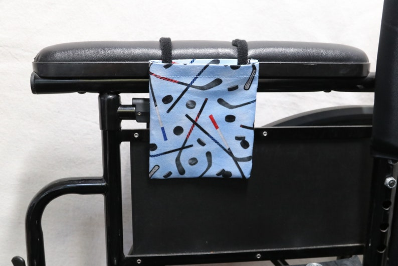 Hockey Sticks and Pucks Armrest Hanging Cell Phone Holder for a Wheelchair Walker or other Mobility Aides