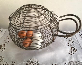 Basket with eggs, snails...