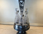 Antique Silver Plate and Etched Crystal Six Cruet Bottles in a Rotating Silver Plate Condiment Caddy
