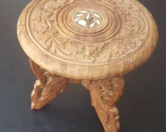 Small carved wood table or plant stand