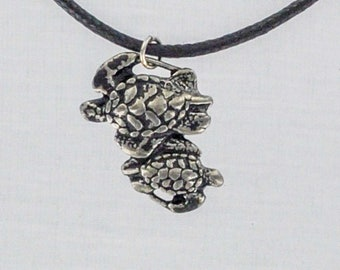 Swimming Turtles in Bright Pewter. Made in USA.