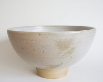 White stoneware bowl with tall foot