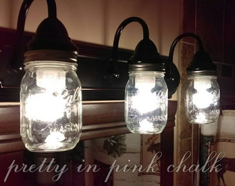 FREE SHIPPING!! Mason jar 3 Light fixture!Bathroom, vanity, etc. Rustic and country look! Lightening. Hanging lights. Oil rubbed bronze!