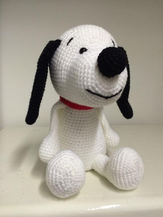 Hand made crochet black and white dog.