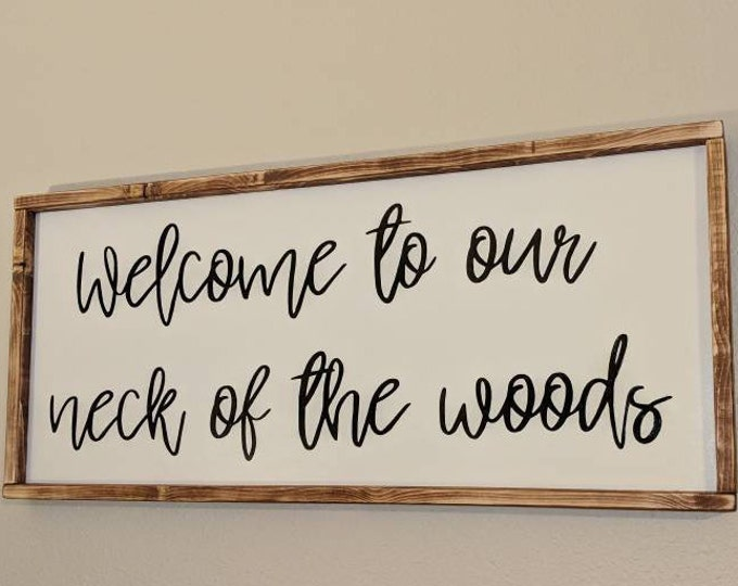 "Large ""Welcome to our neck of the woods"" framed wood sign"