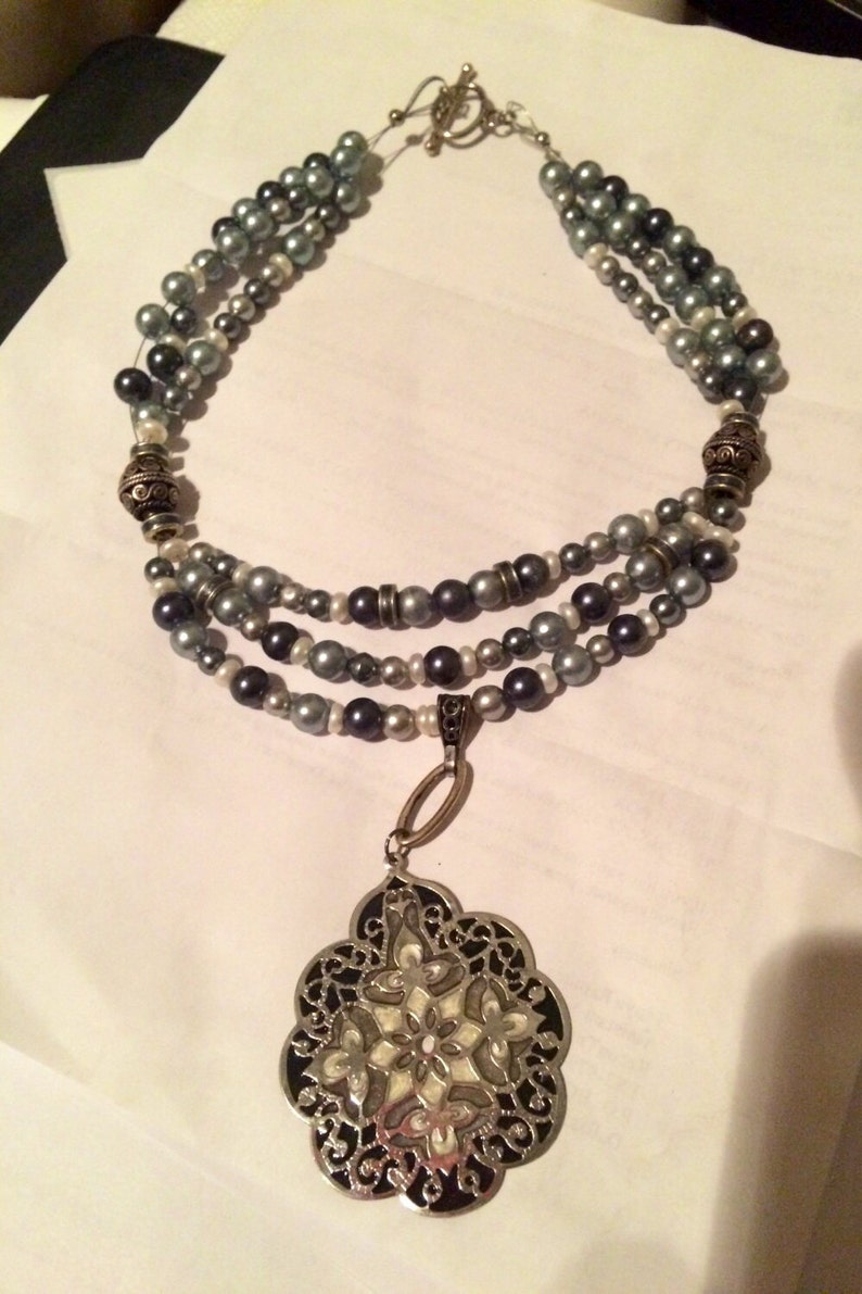 ed7f3d080abfb Pearl triple strand necklace with mother of pearl pendant