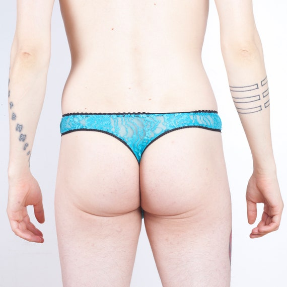 a4d06f1f2f Baby blue lace thong for men with black trim