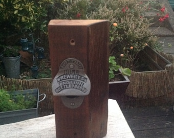 Notting Hill Brewery cast iron wall mounted bottle opener on rustic walnut