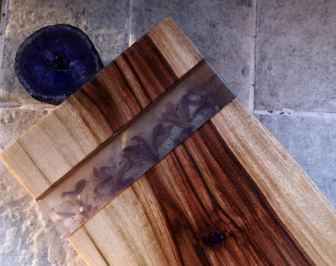 Resin cheese board with purple geode and dried agapanthus flowers