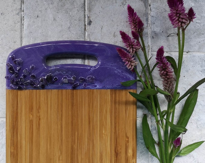Bamboo serving board with resin artwork and amethyst stones