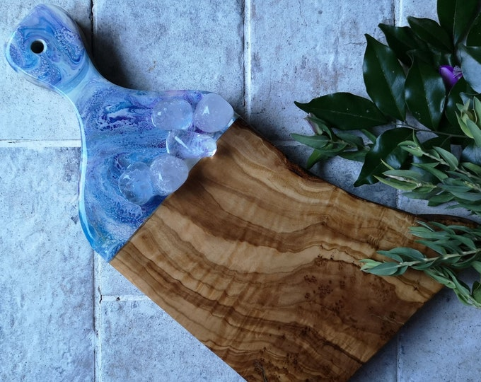 Olivewood serving board with clear quartz crystals