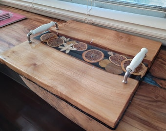 Camphour laurel serving board with inlaid orange slices and white dried flowers