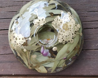 Resin tea light candle holder with dried leaves, flower buds and artwork