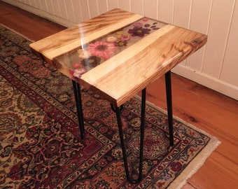 Timber and resin coffee table with botanical inclusions