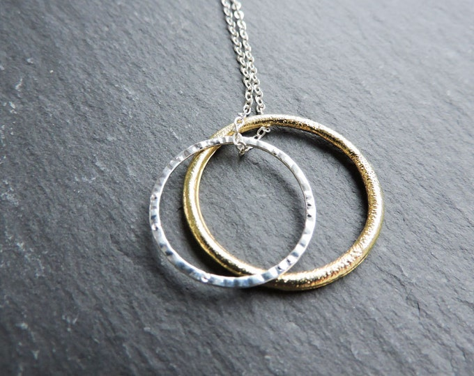 """Silver and Gold Karma textured pendant on long silver necklace - modern sparkle hammered rings - orbit, concentric circles, 28"""" silver chain"""