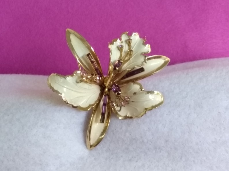 Flower Pin Free US Shipping Vintage Large White and Gold Tone Enameled Orchid Brooch with Lavender Rhinestone Accents Tiny Stone Missing
