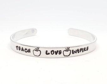 "Teach Love Inspire Hand Stamped Bracelet Aluminum Skinny Cuff apple teacher appreciation teacher Christmas gift - 1/4"" Wide"