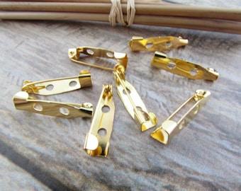 Badges, pin holder, badges color gilt metal, silver, bronze - 2 cm - 65